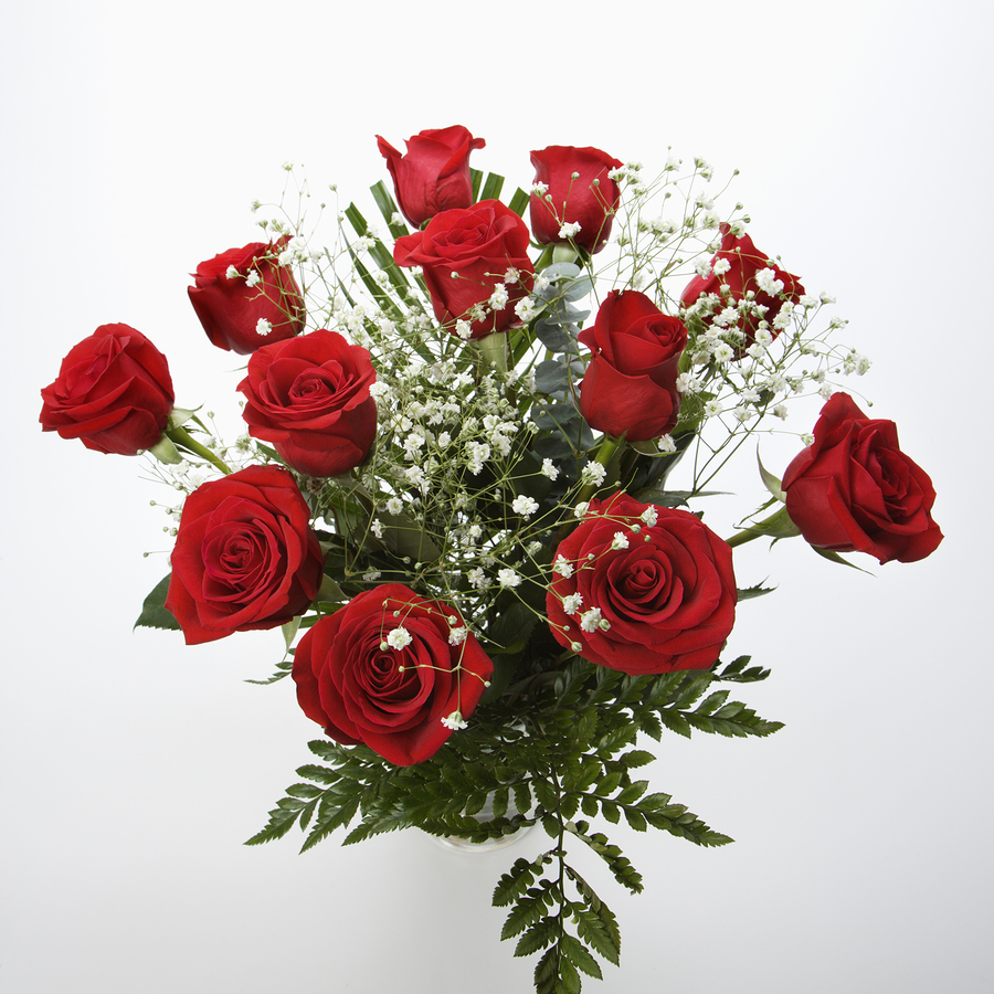 wedding flowers of long-stemmed red roses with baby's breath